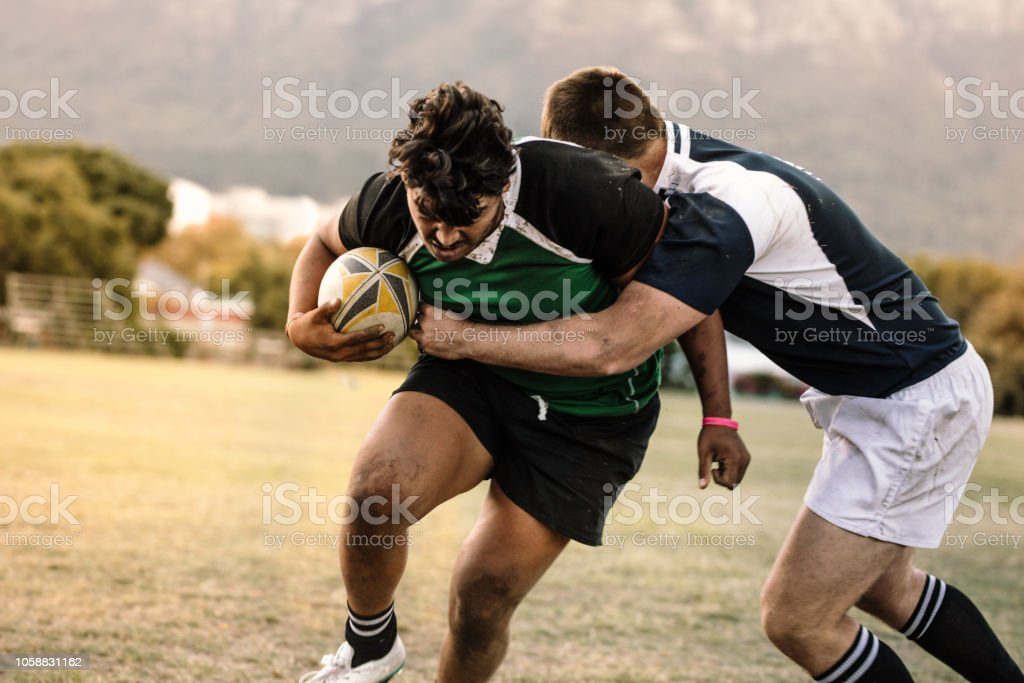Blocking during rugby game stock photo