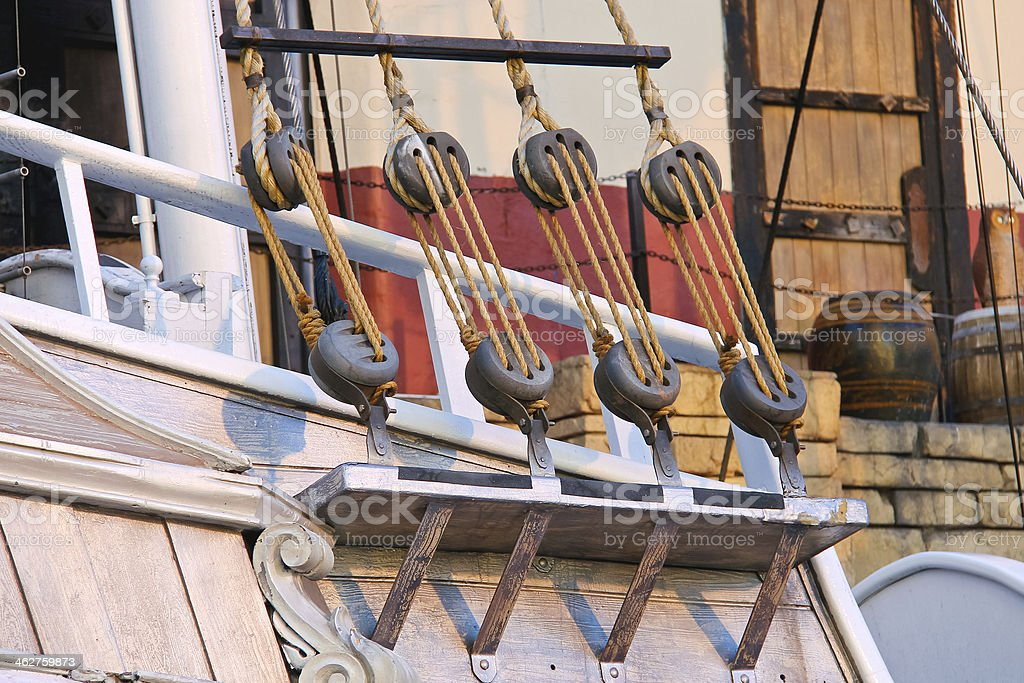 Blocks and ropes on the ancient sailboat stock photo