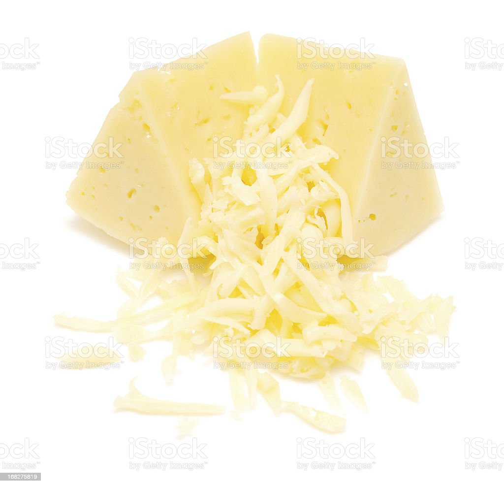 Blocks of mozzarella and shredded cheese stock photo