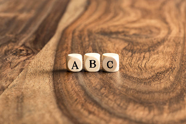 abc blocks on wooden background - alphabetical order stock pictures, royalty-free photos & images