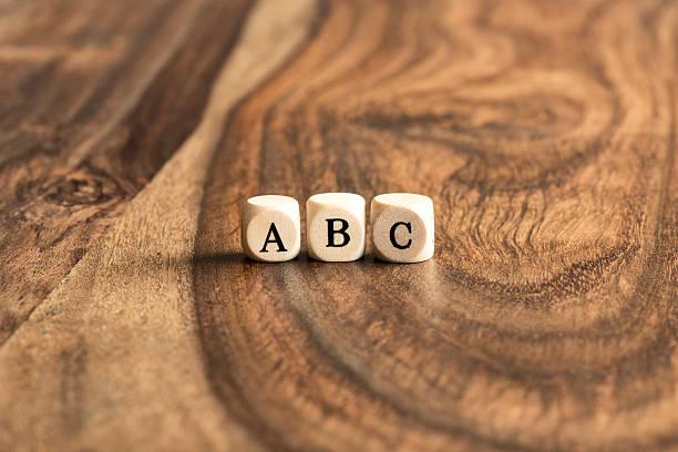 ABC pâtés de maisons sur fond en bois - Photo