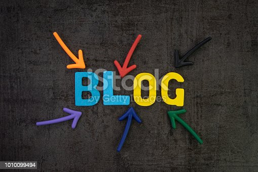 istock Blog, web logs online article and website concept, colorful arrows pointing to the word BLOG at the center of black chalkboard wall, new job for writing article and publish to the internet 1010099494