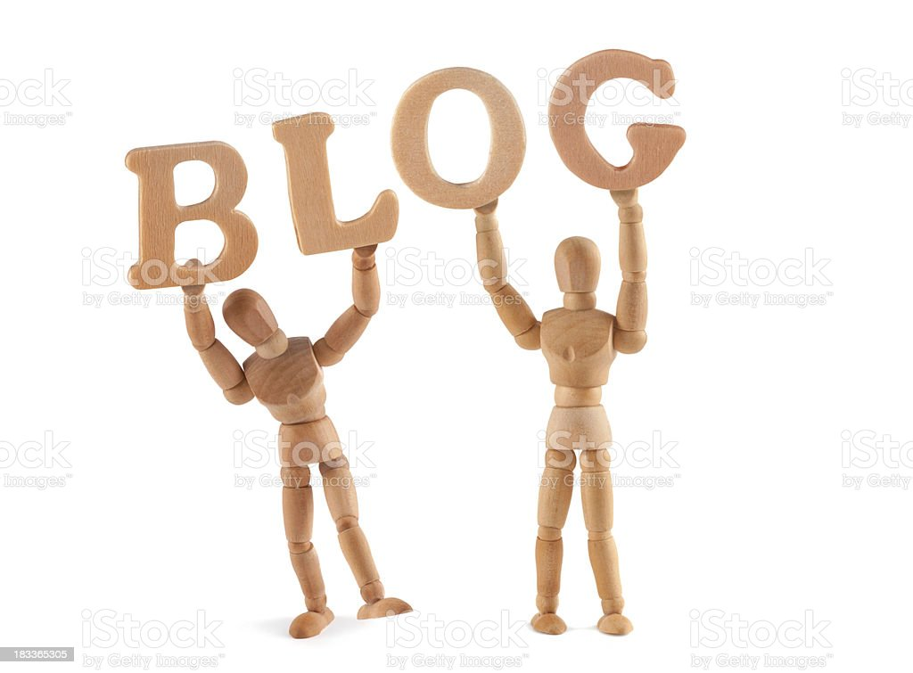 Blog - wooden mannequin holding this word stock photo