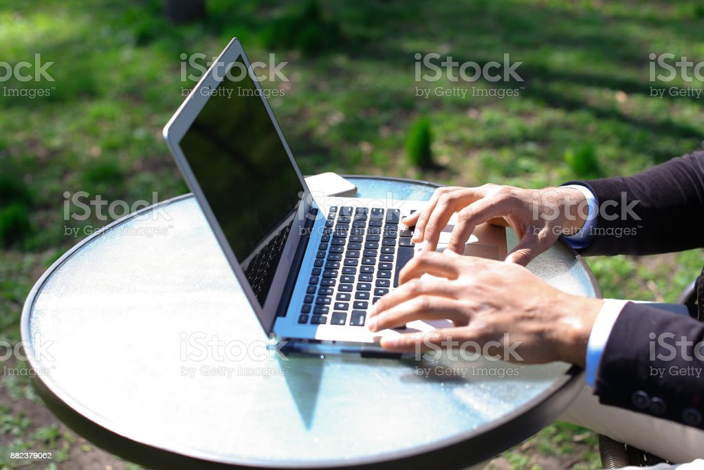 Blogger mounts video on laptop stock photo