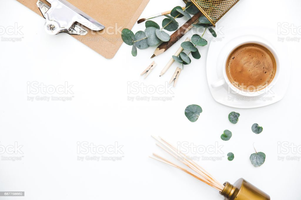 Blogger or freelancer workspace with clipboard and coffee on white background. Flat lay, top view. stock photo