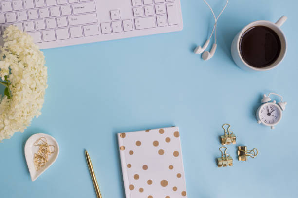 Blogger or freelancer workspace with notebook and white flower hydrangea stock photo