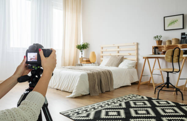 Blogger taking a photo of bedroom stock photo