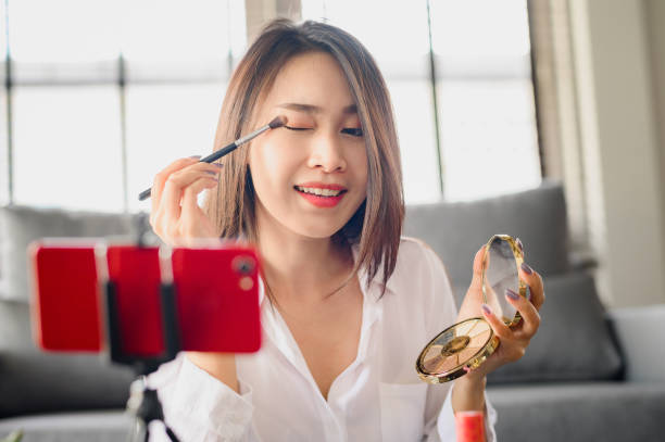 blogger woman recording video makeup cosmetic stock photo