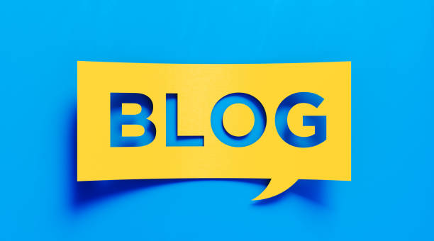 Blogging Concept - Yellow Blog Text  Over Blue Background stock photo