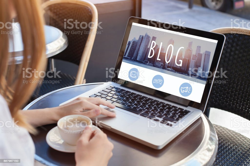blogging, woman reading blog - foto stock