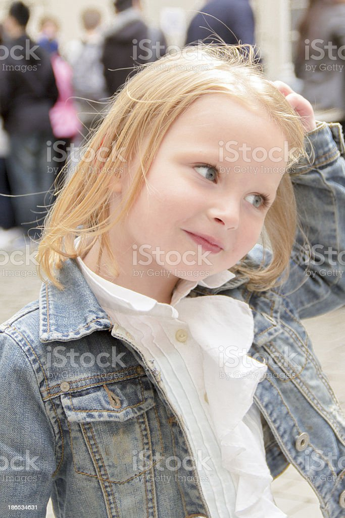 Blond 5 year old with wind swept hair royalty-free stock photo