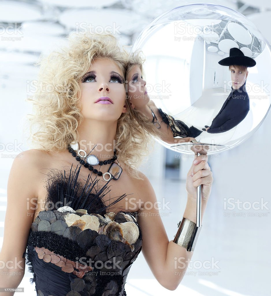 Blond 80s woman with ethnic cancan pearly dress royalty-free stock photo