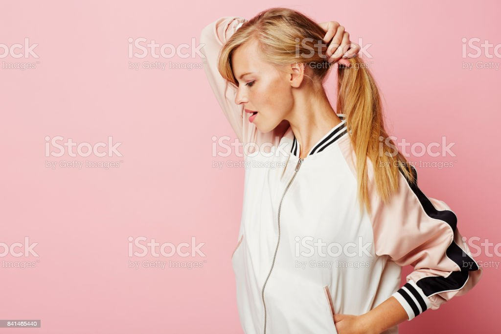 Blond babe in pink stock photo