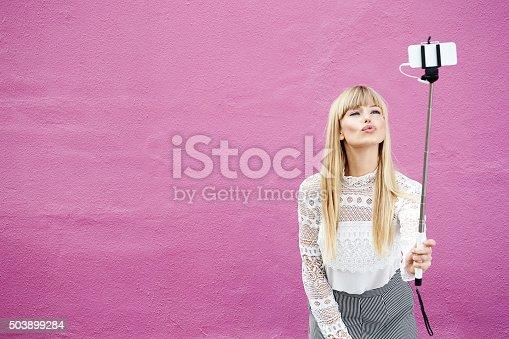 istock Blond beauty kissing for selfie 503899284