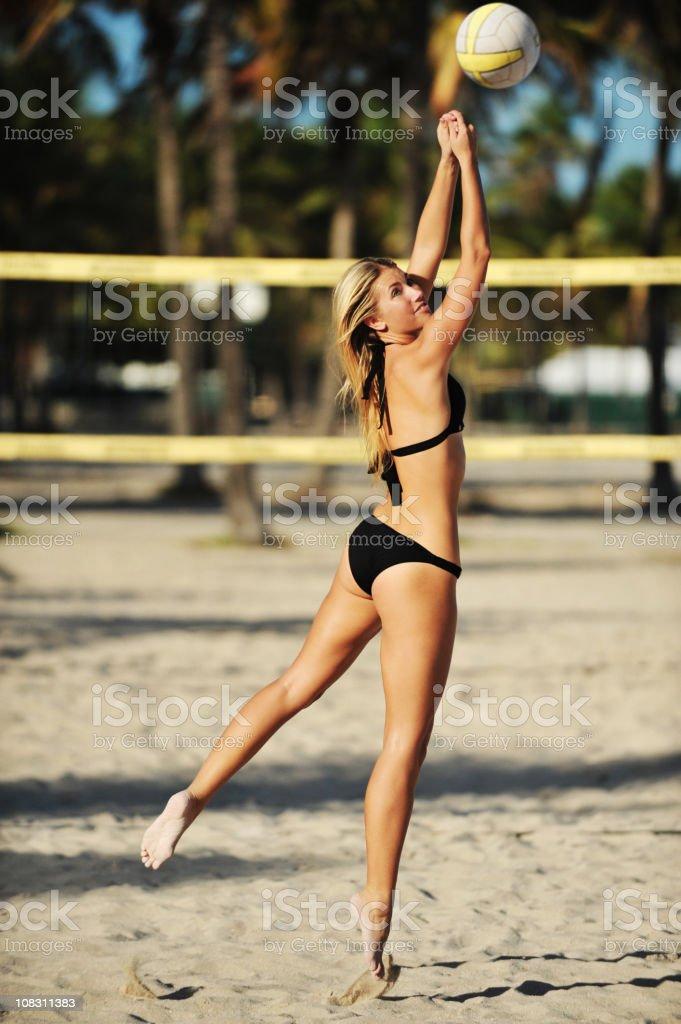 Blond Bikini Woman Playing Beach Volleyball stock photo