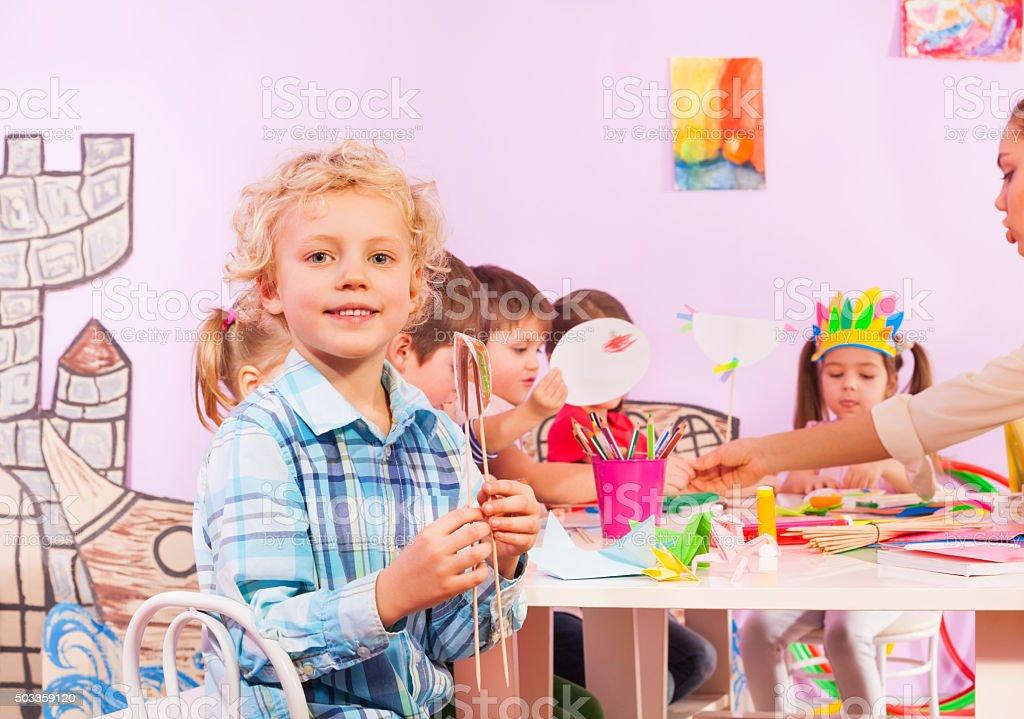 Blond Boy In Preschool Class Sit By Table Stock Photo U0026 More ...