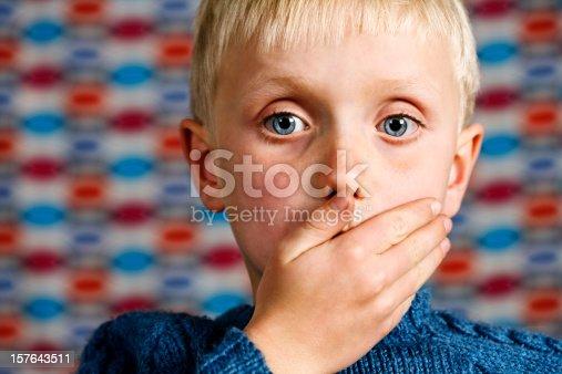 istock Blond boy makes the 'Speak no Evil' gesture 157643511