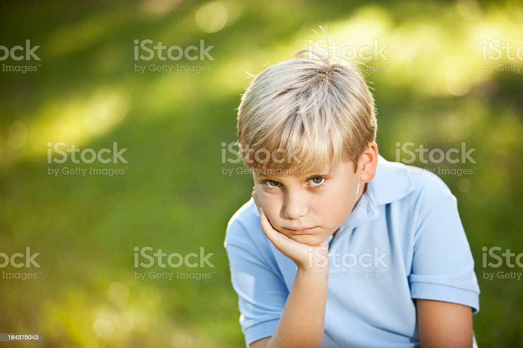 Blond boy outdoors stock photo