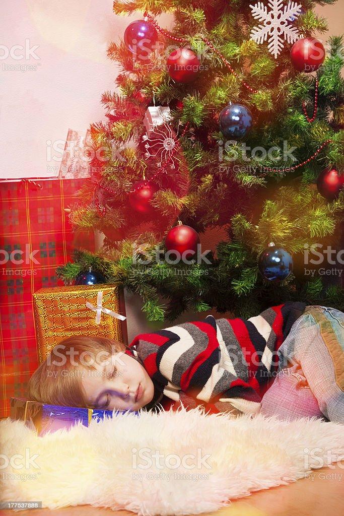 Blond boy overslept Santa royalty-free stock photo