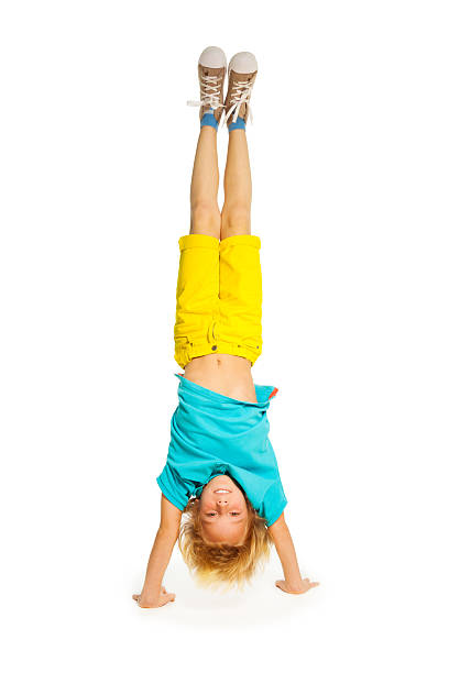 Blond boy standing on hands stock photo
