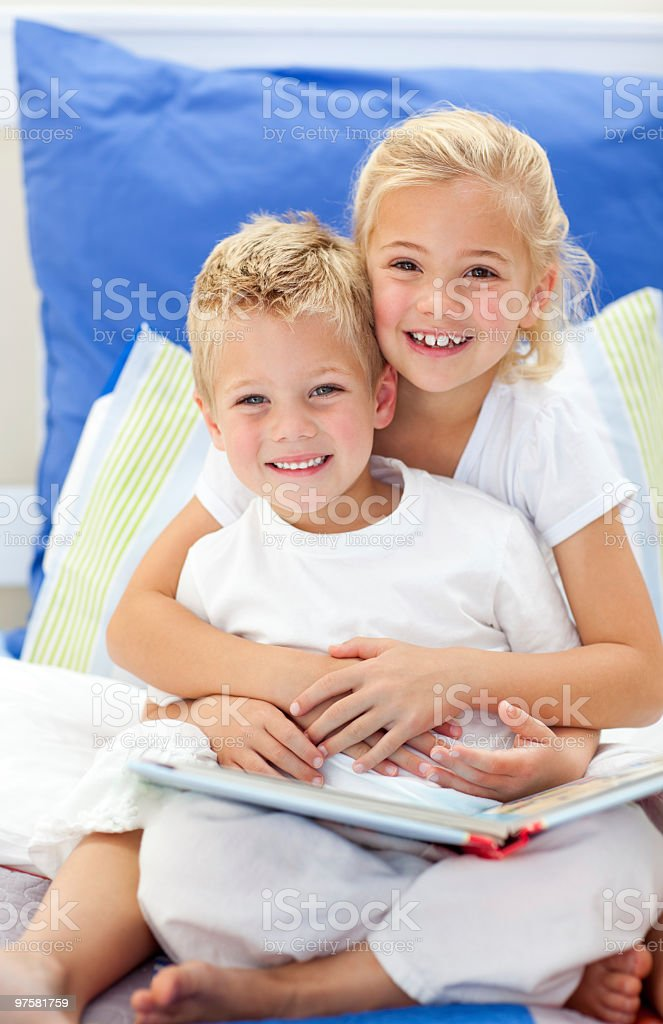 Blond brother and daughter reading books royalty-free stock photo