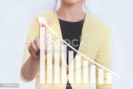 istock blond business woman pointing a chart with finger 1079662918