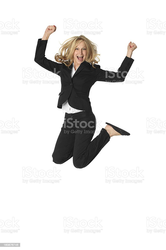 Blond businesswoman jumping for joy royalty-free stock photo