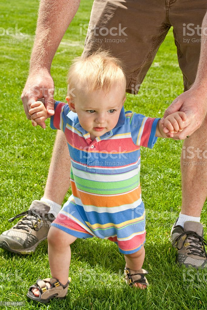Blond Caucasian Toddler Boy Walking with Dad royalty-free stock photo