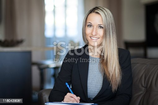 464696188istockphoto Blond Confident Businesswoman Working At Home 1180439081