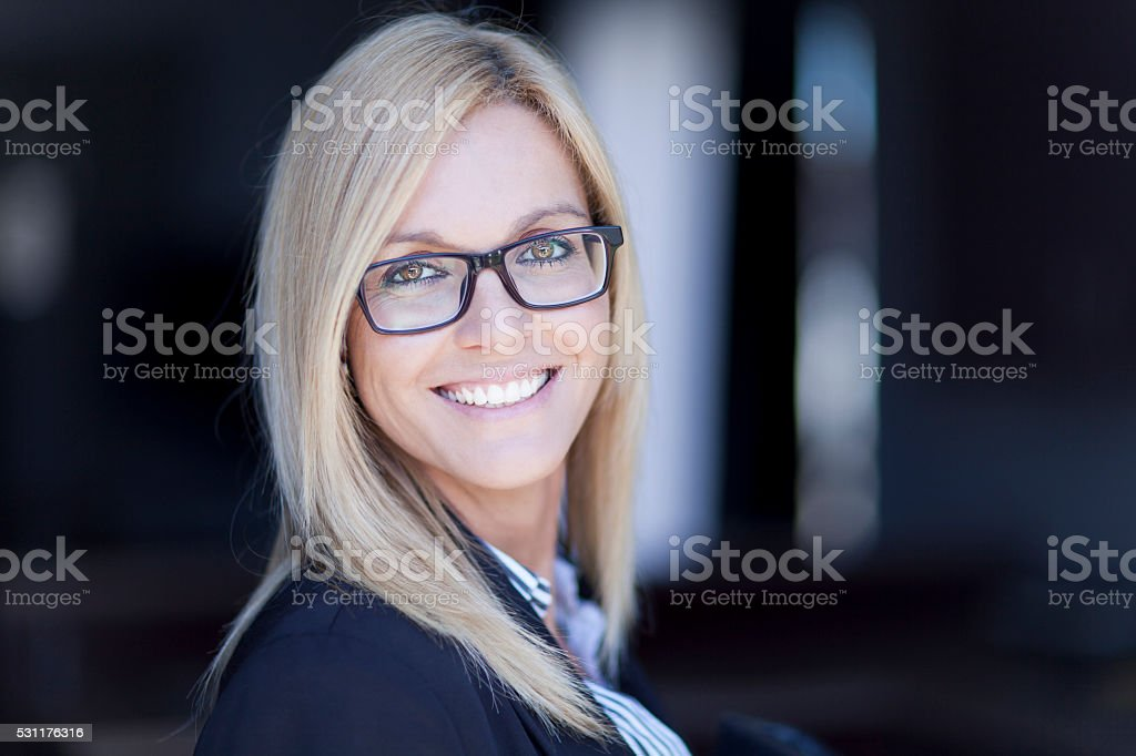 Blond Confident Businesswoman Working At The Office stock photo