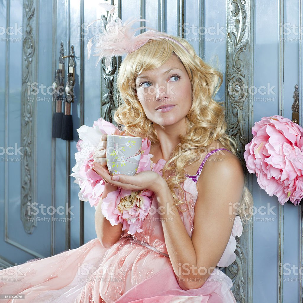 blond fashion princess woman drinking tea or coffee at home royalty-free stock photo