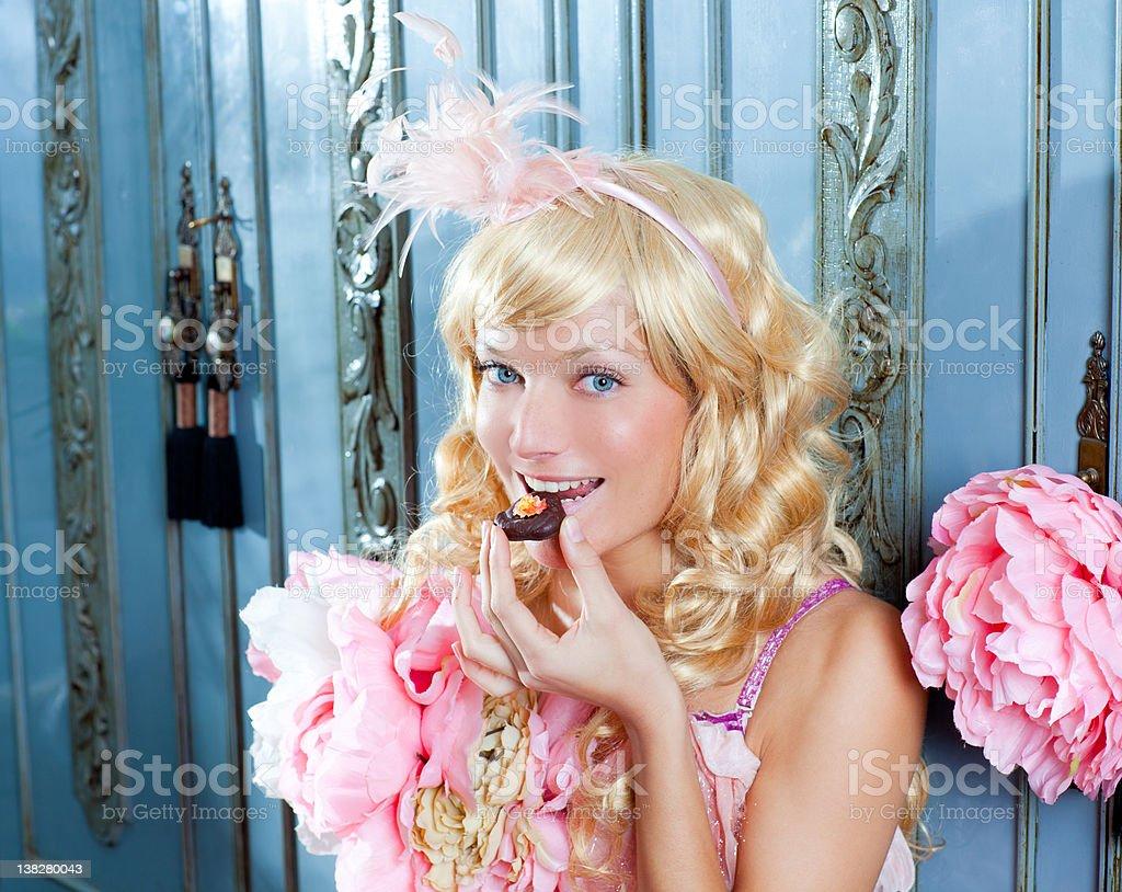 blond fashion princess woman eating chocolate at home royalty-free stock photo