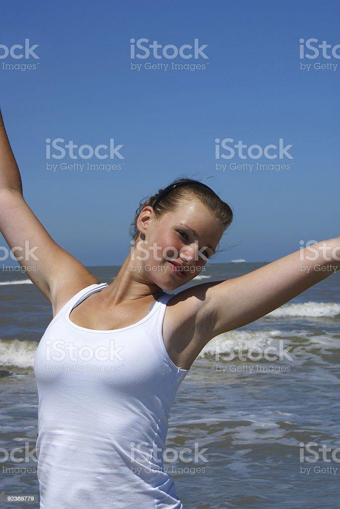 Blond girl, blue sky. royalty-free stock photo