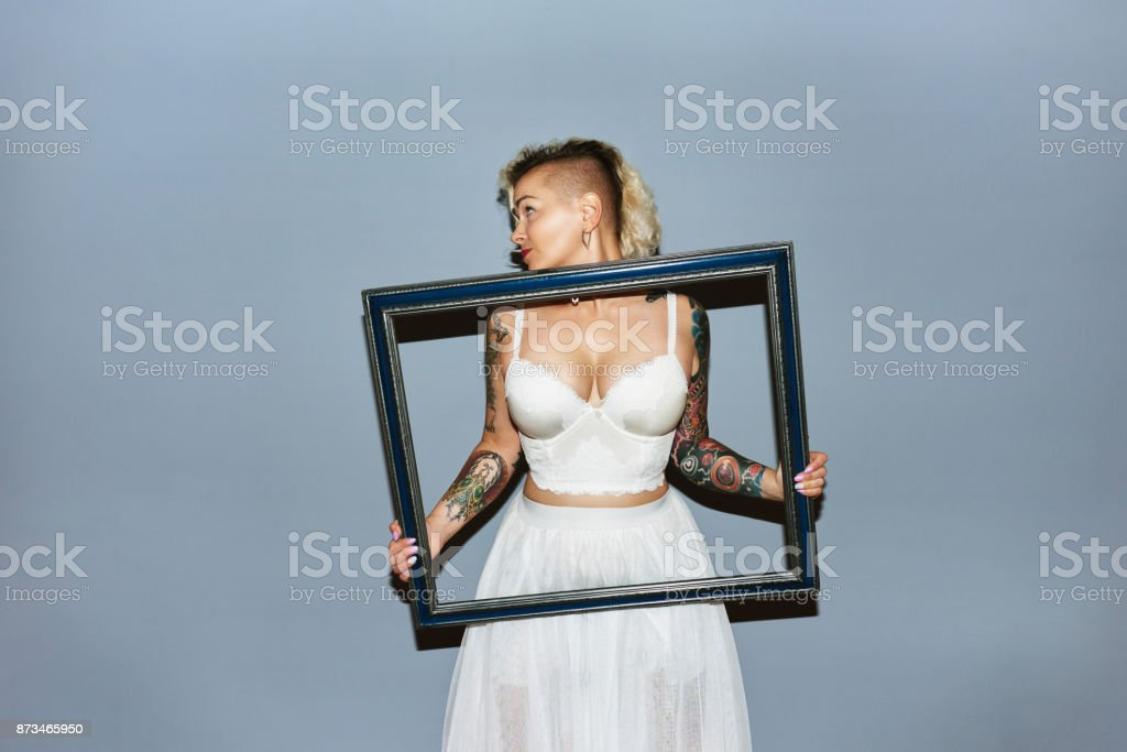 Blond girl goofing around stock photo