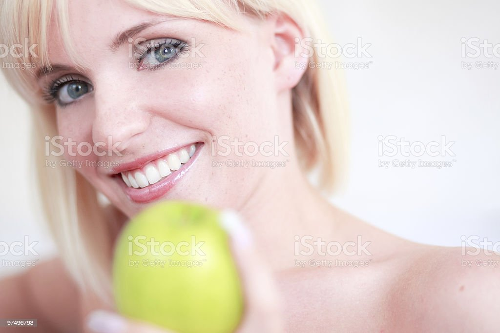 blond girl green apple royalty-free stock photo