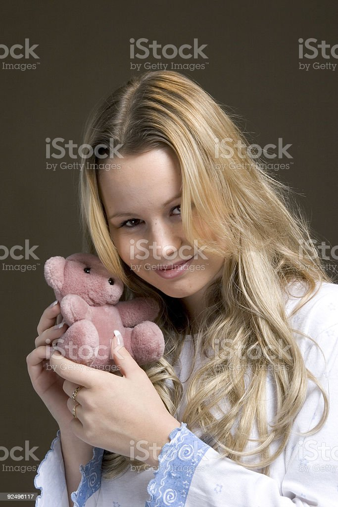 blond girl holding small soft bear royalty-free stock photo