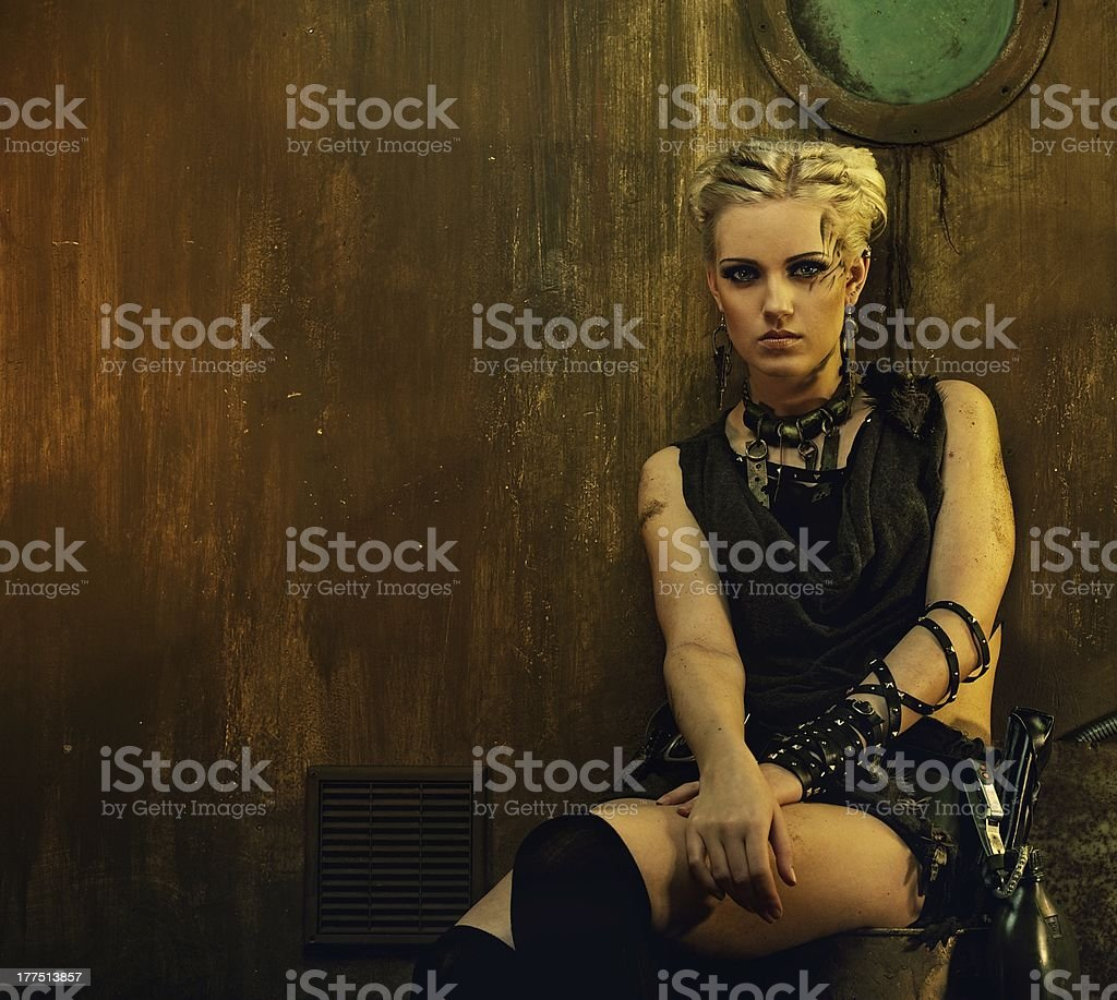 Blond girl in a bunker stock photo