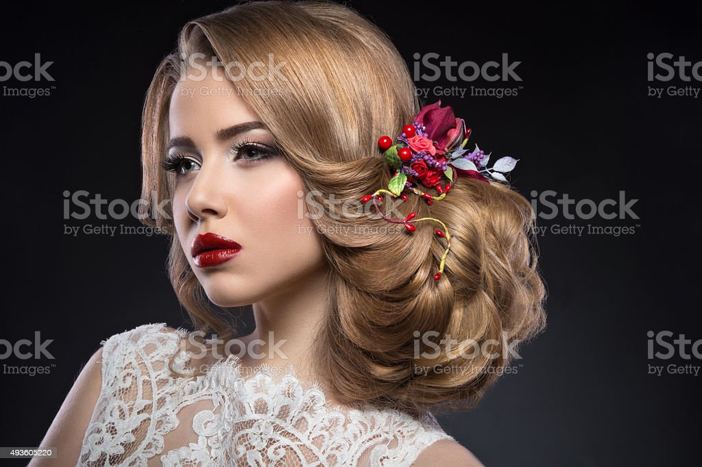 blond girl  in image of bride with purple flowers stock photo