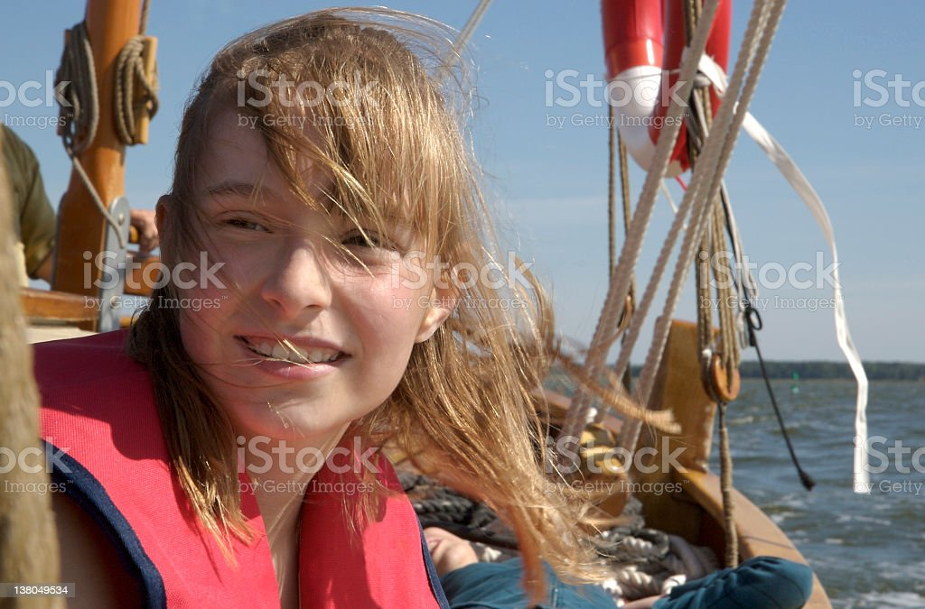 blond girl in life jacket on a sailing boot royalty-free stock photo
