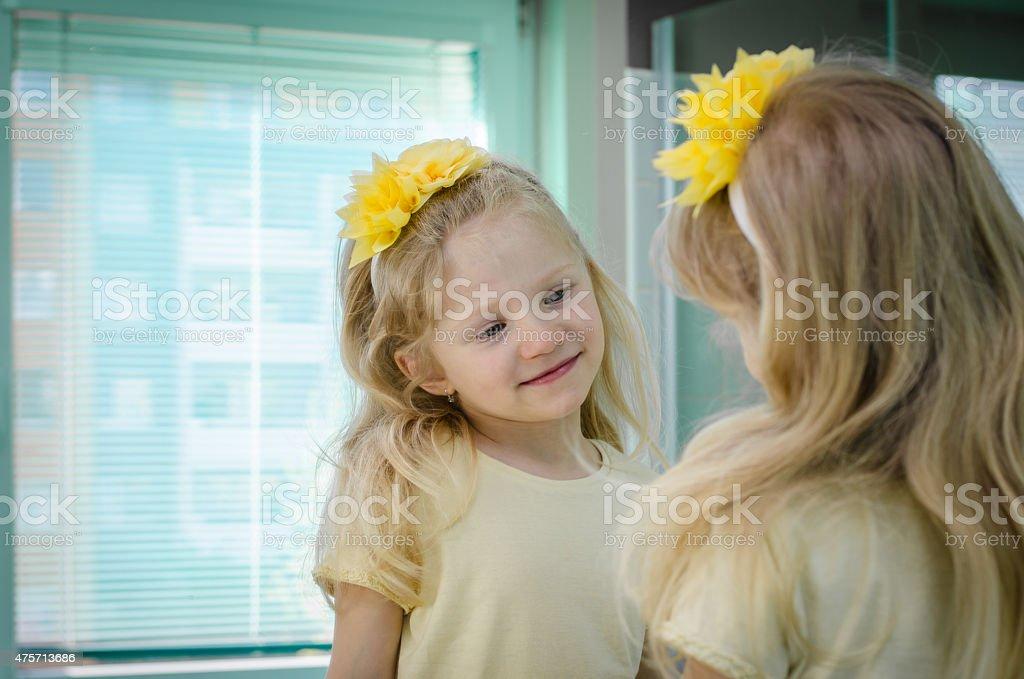 blond girl in mirror stock photo