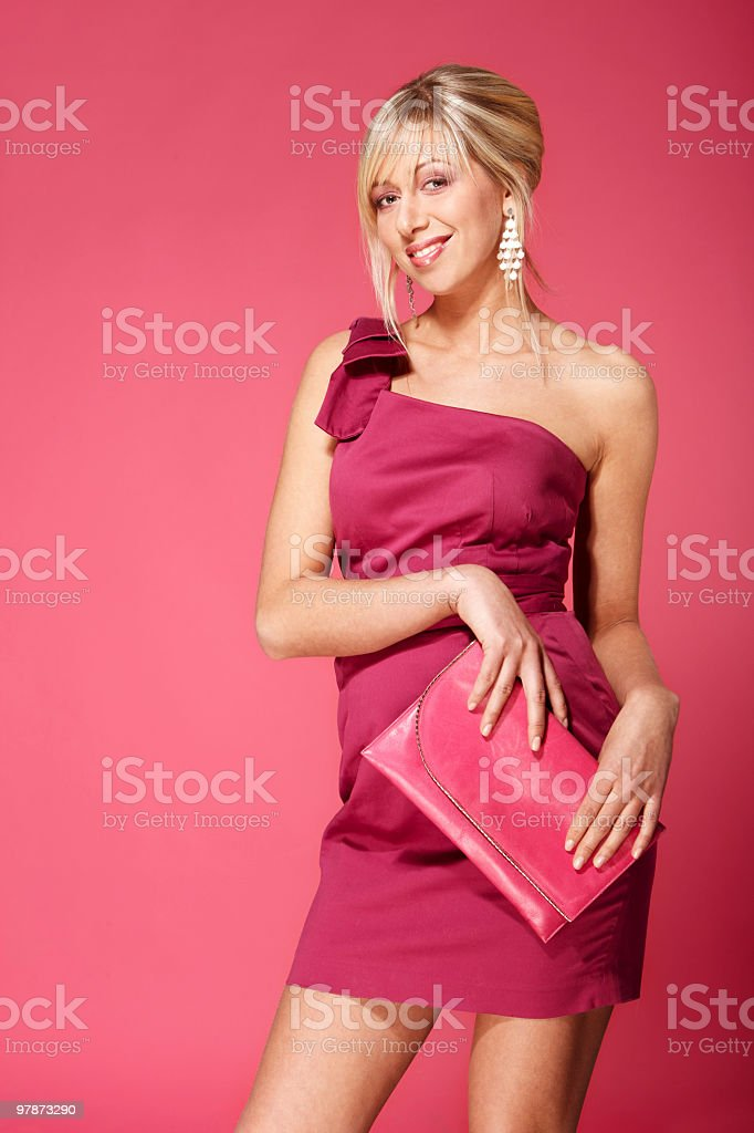 Blond girl in pink stock photo