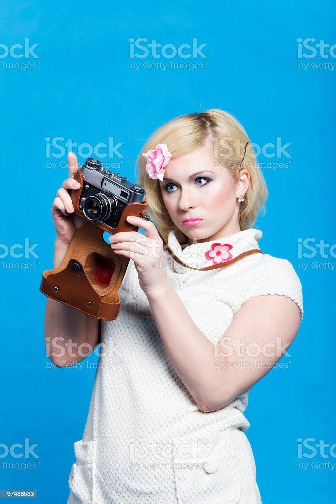 Blond girl look at retro camera royalty-free stock photo