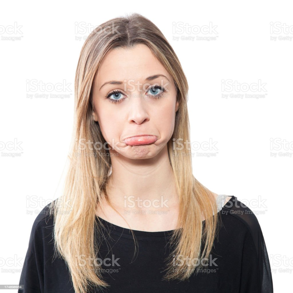Blond girl making a face, sulky royalty-free stock photo