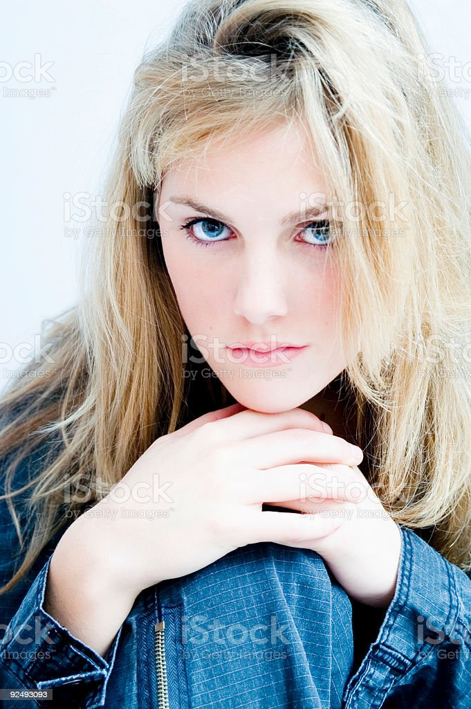 Blond Girl Sitting And Laughing stock photo