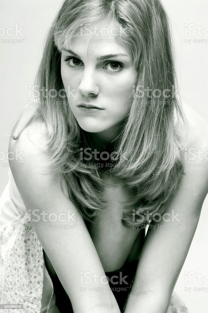Blond Girl Sitting, BW stock photo