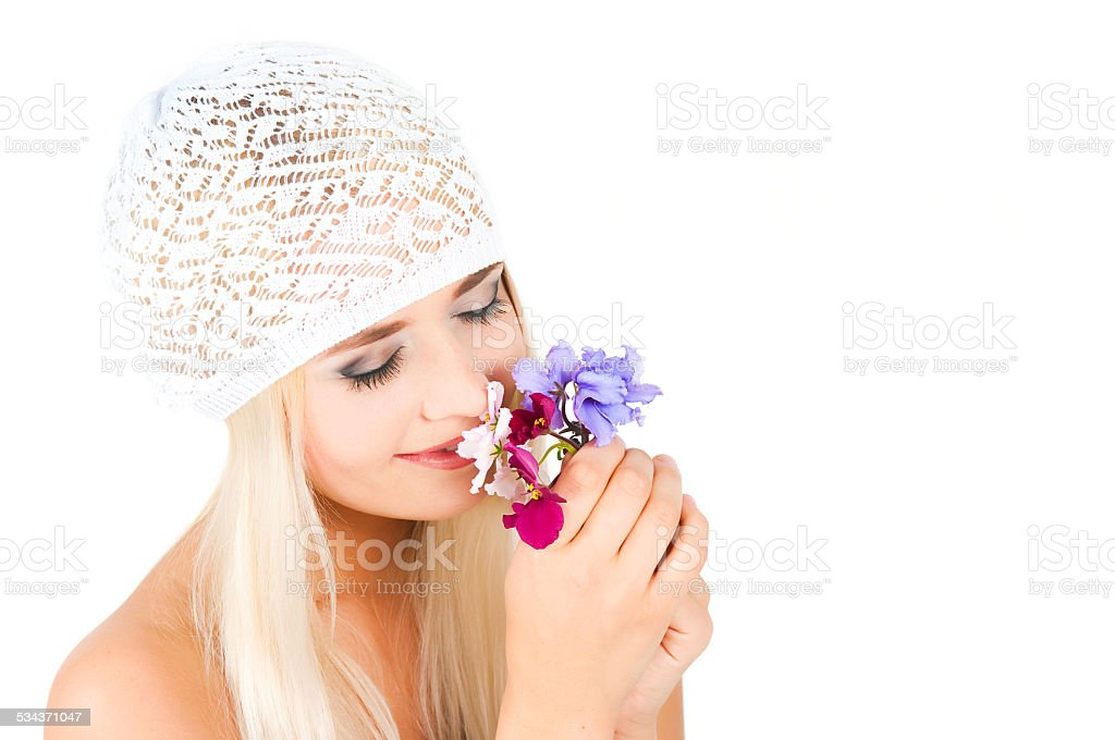 blond girl with a bouquet of violets royalty-free stock photo