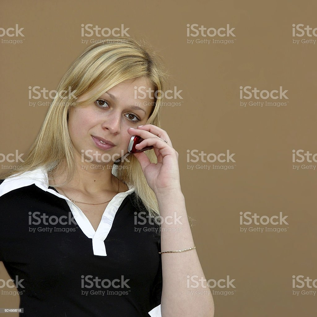 Blond girl with a phone royalty-free stock photo