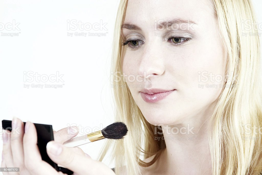 blond girl with make-up kit royalty-free stock photo