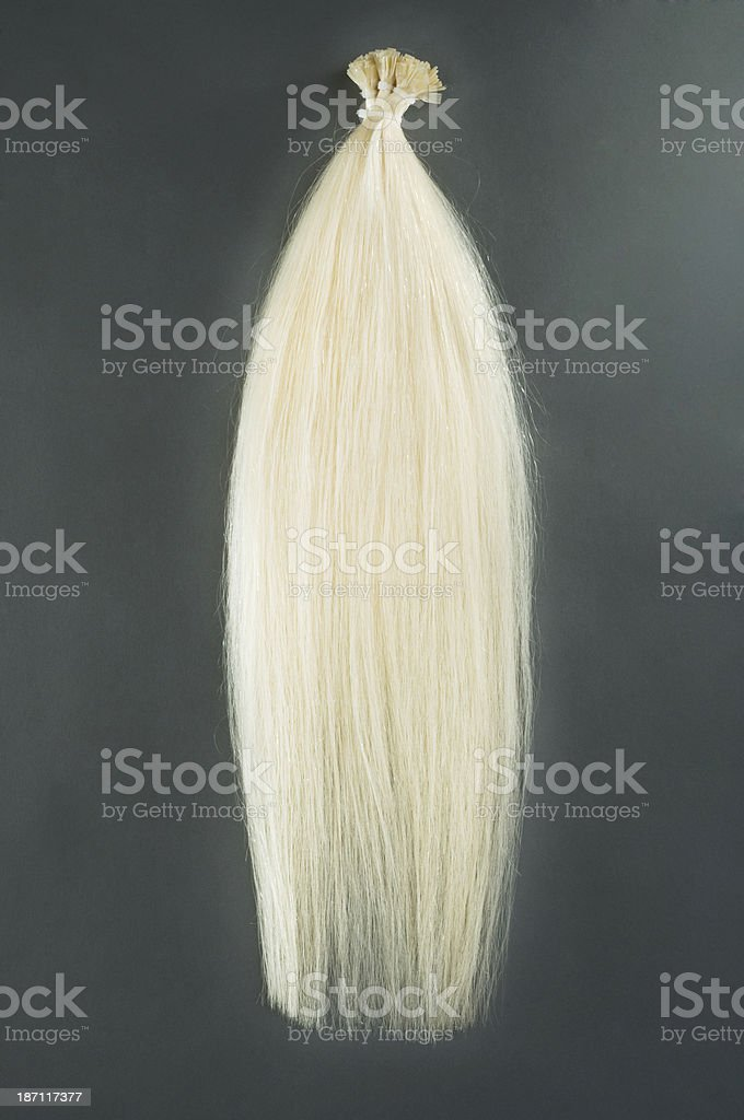 Blond hair extensions royalty-free stock photo