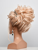 beauty concept, rear view of blond hair mannequin with elegant hairbun.